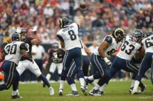 Bradford in action against the Texans. Via- St. Louis Rams
